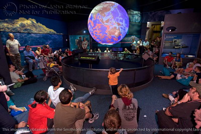 audience viewing Sumatra tsunami animation on NOAA's Sccience on a Sphere at the Smithsonian